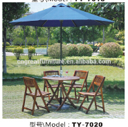 simple round dining table with umbrella hole and outdoor armchair patio Solid chair
