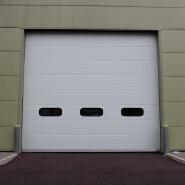Used exterior metal folding garage door