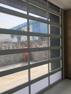 Automatic glass panel sliding stacking top hanging garage door