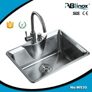 Stainless steel kitchen sink with utensis