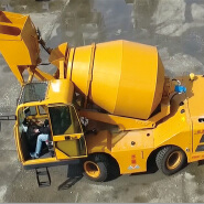 Auto feeding 4 wheel steering portable cement concrete mixer With Loader 4.0cbm for sale in Poland