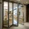 Sunnyquick aluminum glass bi-folding door exterior aluminium alloyed folding sliding doors house for sell