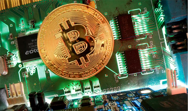 Bitcoin drops after climbing to all-time high
