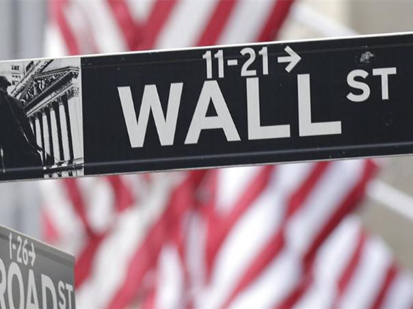 Dow edges to record but Nasdaq falls again